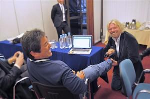 Richard Branson washing Guy Kawasaki's feet
